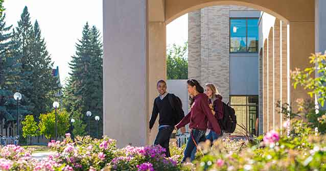 Three students walking on Concordia Campus