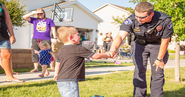 Officer shakes boy's hand